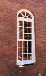 Arched sliding sash window